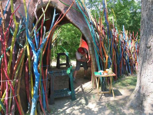 Installation of brightly colored painted sticks