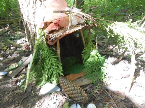 Enchanted Forest fairy house 2015 built of nataural materials from the park and volunteers.  sticks, pinecodes, stones, evergreens.