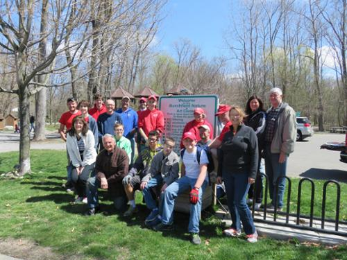 Volunteers pose for a group photo after they prep the park for springtime.
