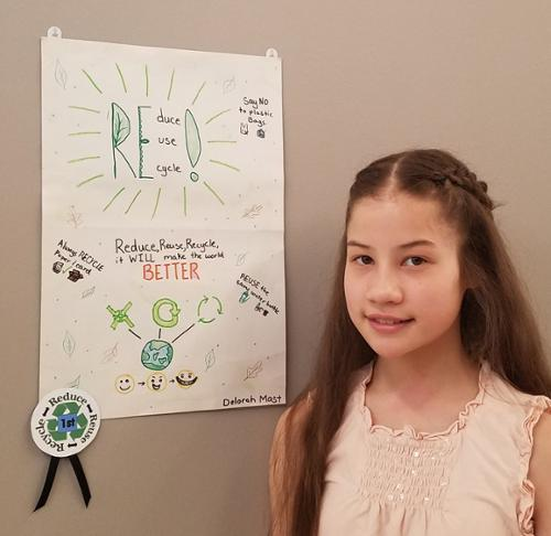 Recycle Reduce Reuse poster contest winner first place smiling girl